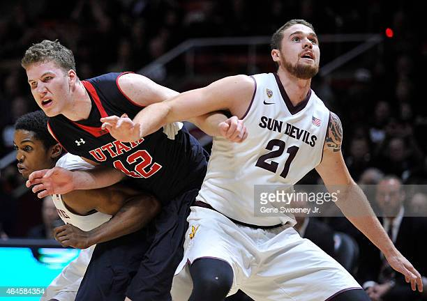 Jakob Poeltl of the Utah Utes battles between Shaquielle McKissic and Eric Jacobsen of the Arizona State Sun Devils for a second half rebound at the...