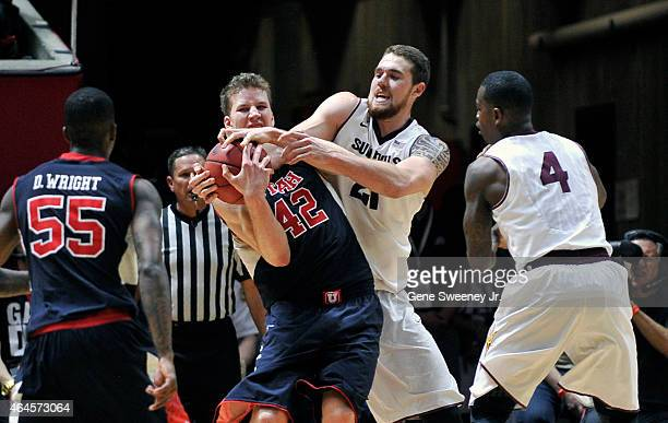 Jakob Poeltl of the Utah Utes battles for the rebound against Eric Jacobsen of the Arizona State Sun Devils during firsthalf action at the Jon M...