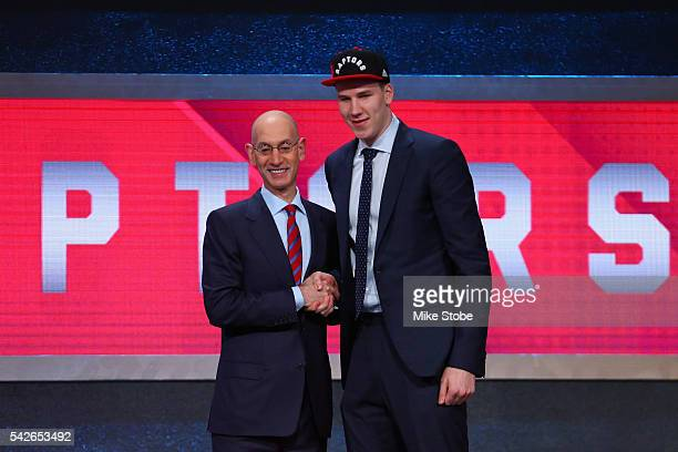 Jakob Poeltl poses with Commissioner Adam Silver after being drafted ninth overall by the Toronto Raptors in the first round of the 2016 NBA Draft at...