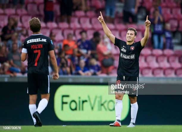 Jakob Poulsen and Erik Sviatchenko of FC Midtjylland celebrate after the Danish Superliga match between FC Midtjylland and Esbjerg fB at MCH Arena on...