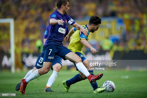 Jakob Poulsen of FC Midtjylland and Besar Halimi of Brondby IF compete for the ball during the Danish Alka Superliga match between Brondby IF and FC...