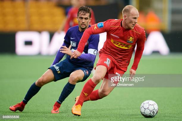 Jakob Poulsen of FC Midtjylland and Mikkel Rygaard of FC Nordsjalland in action during the Danish Alka Superliga match between FC Nordsjalland and FC...
