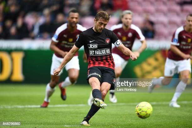 Jakob Poulsen of FC Midtjylland scores the 20 goal on a penalty kick during the Danish Alka Superliga match between FC Midtjylland and Hobro IK at...