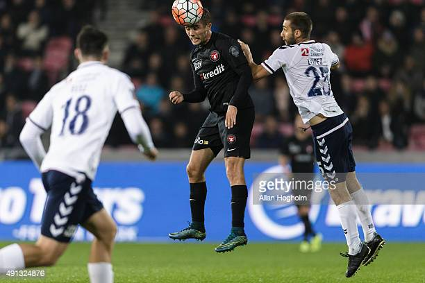 Jakob Poulsen of Midtjylland and Adrian Lopez of AGF Aarhus compete for the ball during the Danish Alka Superliga match between FC Midtjylland and...