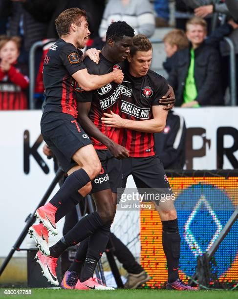 Jakob Poulsen Paul Onuachu Jonas Borring of FC Midtjylland celebrate after scoring their first goal during the Danish Alka Superliga match between FC...