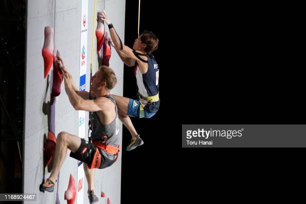 Jakob Schubert of Austria and Jongwon Chon of South Korea compete in the Speed during Combined Men's Qualification on day nine of the IFSC Climbing...