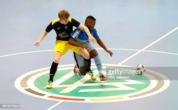 Jakob Sievert of Hunrueck challenges Mamadou Sow of Blumenthaler SV during the DFB Indoor Football match between Blumenthaler SV and JFV...