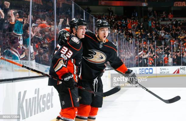Jakob Silfverberg and Brandon Montour of the Anaheim Ducks celebrate after Silfverberg scored a thirdperiod goal during the game against the...