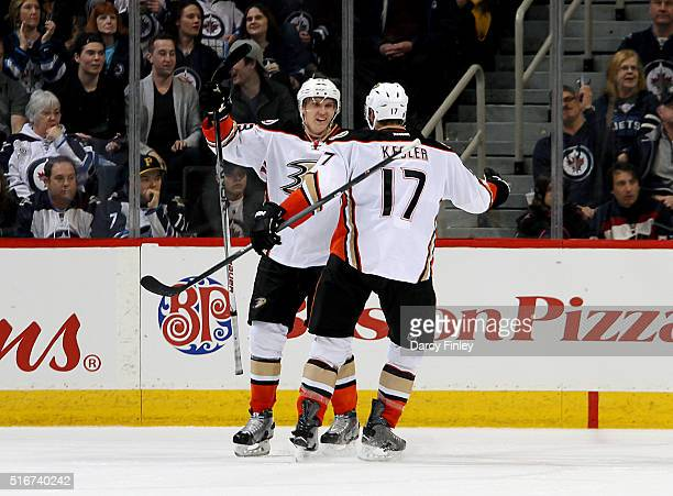 Jakob Silfverberg and Ryan Kesler of the Anaheim Ducks celebrate an overtime goal against the Winnipeg Jets at the MTS Centre on March 20 2016 in...