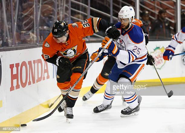 Jakob Silfverberg of the Anaheim Ducks battles for a loose puck with Darnell Nurse of the Edmonton Oilers during a game at Honda Center on November...