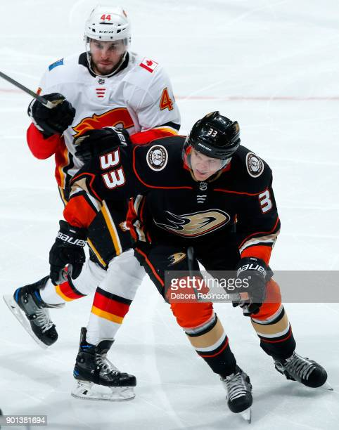 Jakob Silfverberg of the Anaheim Ducks battles for position against Matt Bartkowski of the Calgary Flames during the game on December 29, 2017 at...