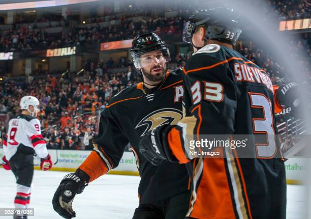 Jakob Silfverberg of the Anaheim Ducks celebrates his firstperiod goal with Ryan Kesler during the game against the New Jersey Devils at Honda Center...