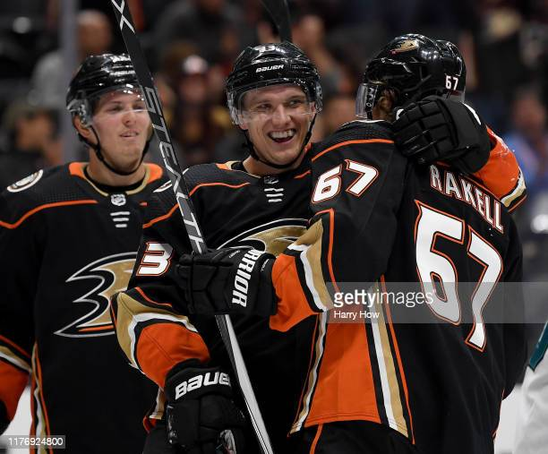 Jakob Silfverberg of the Anaheim Ducks celebrates his goal with Rickard Rakell and Isac Lundestrom to take a 2-0 lead over the San Jose Sharks during...