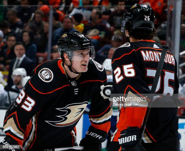 Jakob Silfverberg of the Anaheim Ducks chats with Brandon Montour prior to a faceoff during the game against the Vancouver Canucks on March 14 2018...