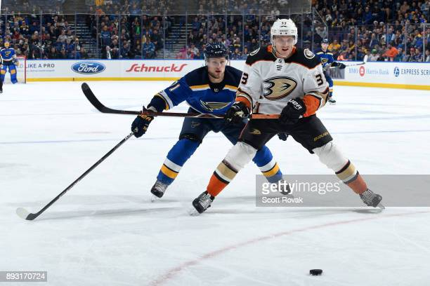 Jakob Silfverberg of the Anaheim Ducks heads towards the puck as Vladimir Sobotka of the St Louis Blues pressures at Scottrade Center on December 14...