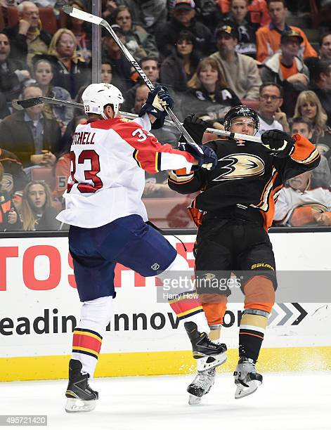 Jakob Silfverberg of the Anaheim Ducks is stood up with a check from Willie Mitchell of the Florida Panthers during the first period at Honda Center...