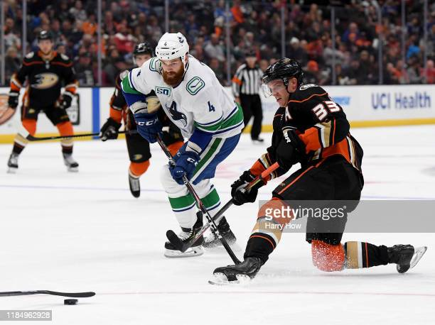 Jakob Silfverberg of the Anaheim Ducks loses the puck in front of Jordie Benn of the Vancouver Canucks during the third period in a 2-1 overtime...