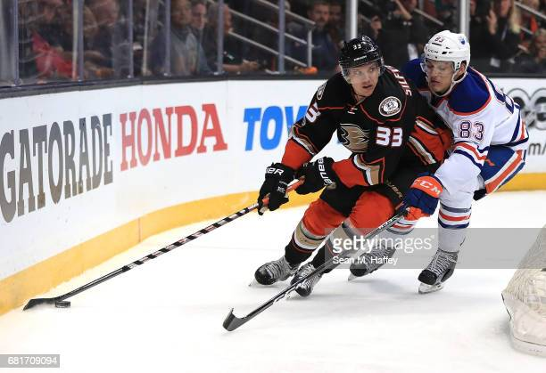 Jakob Silfverberg of the Anaheim Ducks skates against Matthew Benning of the Edmonton Oilers in Game Seven of the Western Conference Second Round...