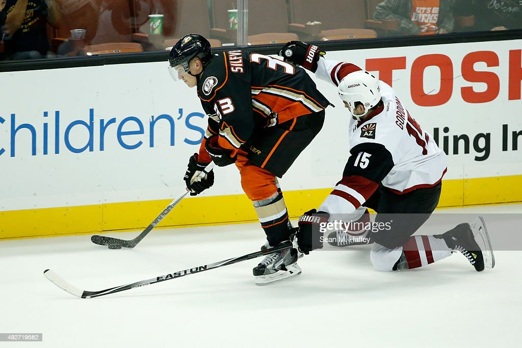 Jakob Silfverberg #33 of the Anaheim Ducks skates past Boyd Gordon #15 of the Arizona Coyotes during the third period of a game at Honda Center on October 14, 2015 in Anaheim, California.