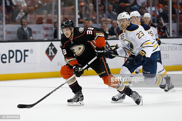 Jakob Silfverberg of the Anaheim Ducks skates past Sam Reinhart of the Buffalo Sabres during the third period of a game at Honda Center on February...