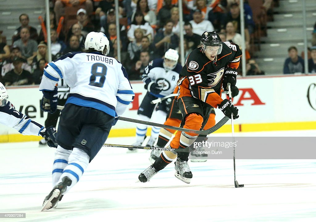 Jakob Silfverberg #33 of the Anaheim Ducks skates with the puck against Jacob Trouba #8 of the Winnipeg Jets in Game Two of the Western Conference Quarterfinals during the 2015 NHL Stanley Cup Playoffs at Honda Center on April 18, 2015 in Anaheim, California. The Ducks won 2-1.