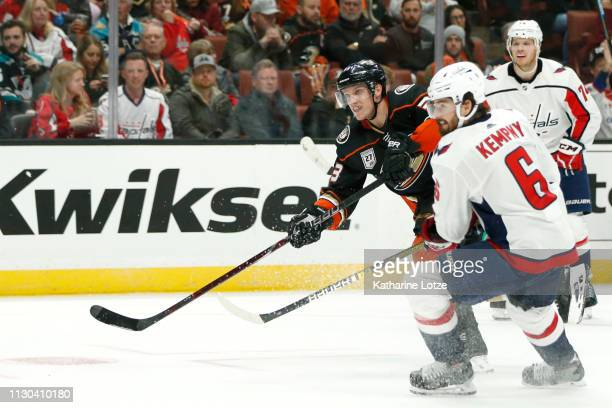 Jakob Silfverberg of the Anaheim Ducks takes a shot on goal as Michal Kempny of the Washington Capitals looks on during the third period at Honda...