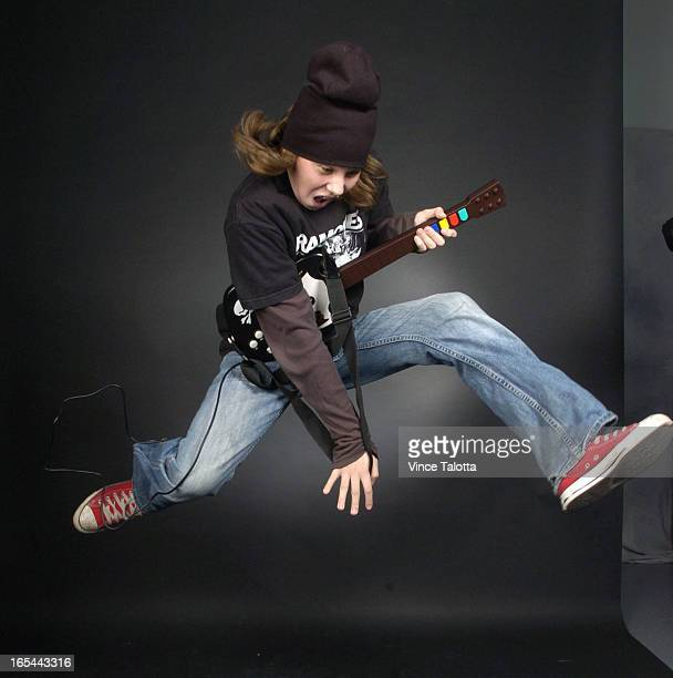4/05/2006 Jakob tanner is going to testdrive a hot new videogame called Guitar Hero Before we send it home to him we'd like a dude shot with him in a...
