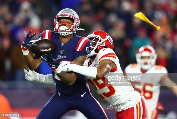 Jakobi Meyers of the New England Patriots attempts to catch a pass as pass interference is called against Kendall Fuller of the Kansas City Chiefs...