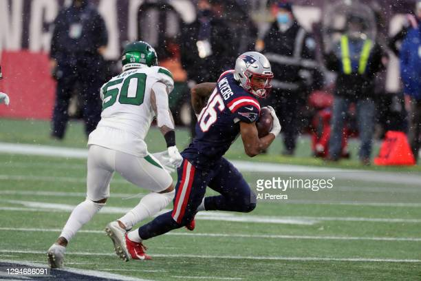Jakobi Meyers of the New England Patriots has a long gain against the New York Jets at Gillette Stadium on January 3, 2021 in Foxborough,...