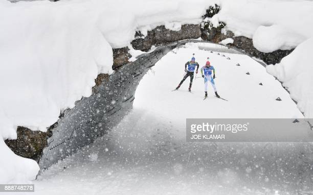 Jakov Fak of Slovenia and Simon Schempp of Germany compete during the men's 125 km pursuit event at the IBU World Cup Biathlon in Hochfilzen Austria...