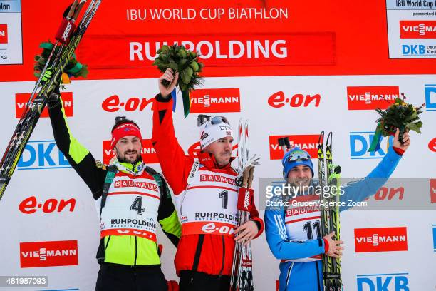 Jakov Fak of Slovenia takes 2nd place, Emil Hegle Svendsen of Norway takes 1st place, Evgeniy Garanichev of Russia takes 3rd place during the IBU...