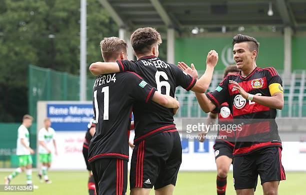 Jakub Bednarczyk of Leverkusen celebrates after scoring his team's second goal with Riccardo Grym and Atakan Akkaynak during the U17 German...