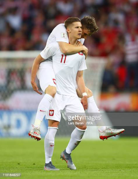 Jakub Bednarczyk of Poland celebrates as he scores his team's first goal with team mate Serafin Szota during the 2019 FIFA U-20 World Cup group A...