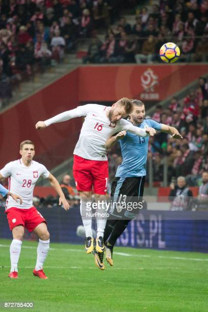 Jakub Blaszczykowski and Gaston Silva during the international friendly soccer match between Poland and Uruguay at the PGE National Stadium in Warsaw...