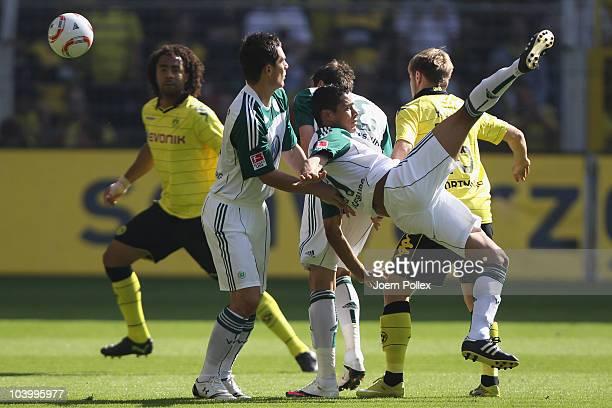 Jakub Blaszczykowski of Dortmund and Cicero of Wolfsburg battle for the ball during the Bundesliga match between Borussia Dortmund and VfL Wolfsburg...