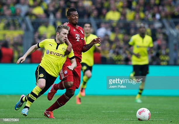 Jakub Blaszczykowski of Dortmund and Jerome Boateng of Muenchen compete for the ball during the Bundesliga match between Borussia Dortmund and FC...