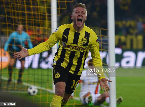 Jakub Blaszczykowski of Dortmund celebrates after scoring his teams third goal during the UEFA Champions League round of 16 second leg match between...