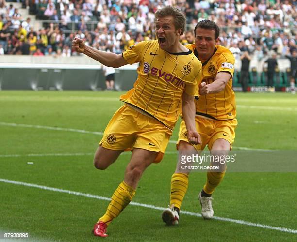 Jakub Blaszczykowski of Dortmund celebrates his first goal with Alexander Frei during the Bundesliga match between Borussia Moenchengladbach and...