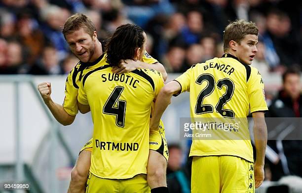 Jakub Blaszczykowski of Dortmund celebrates scoring his team's first goal with team mates Neven Subotic and Sven Bender during the Bundesliga match...