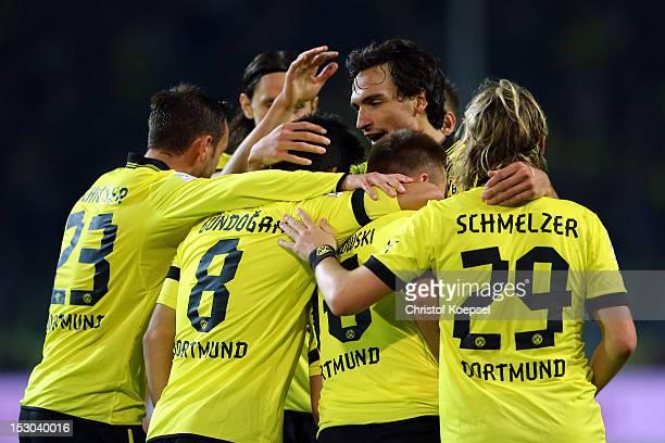Jakub Blaszczykowski of Dortmund celebrates the fifth goal with his team mates during the Bundesliga match between Borussia Dortmund and VfL Borussia...