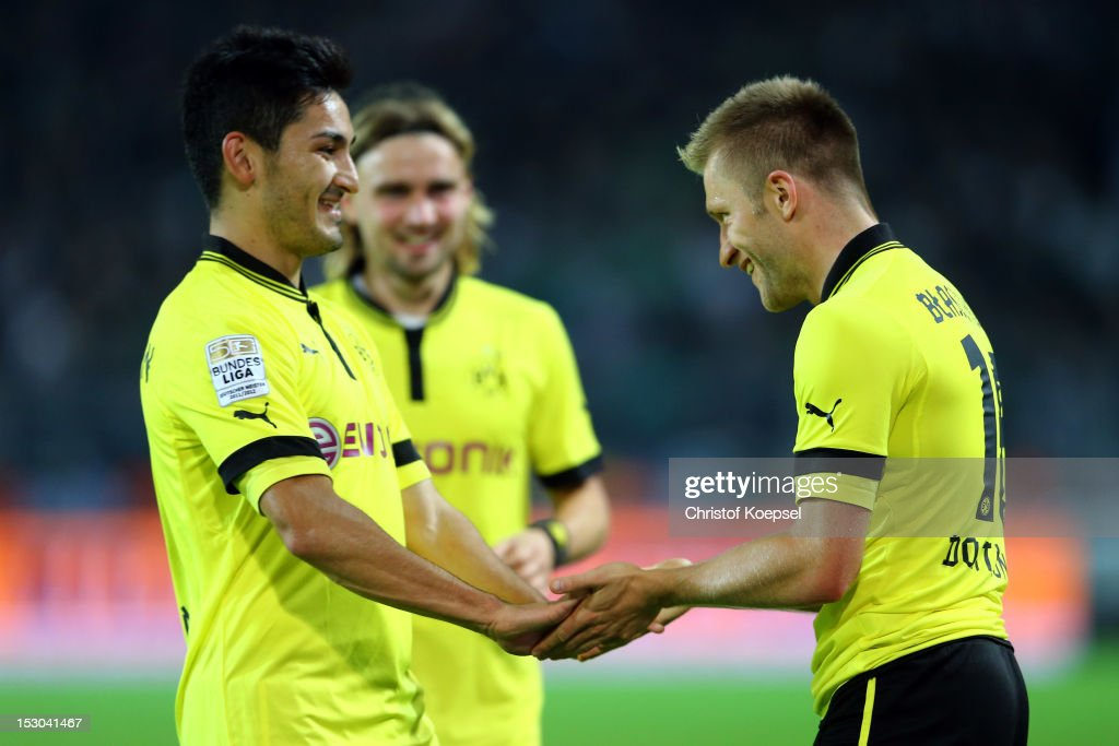 Jakub Blaszczykowski of Dortmund (R) celebrates the fifth goal with Ilkay Guendogan (L) during the Bundesliga match between Borussia Dortmund and VfL Borussia Moenchengladbach at Signal Iduna Park on September 29, 2012 in Dortmund, Germany.