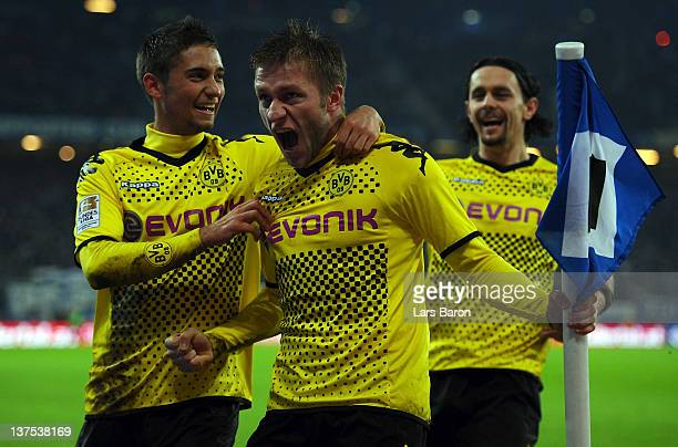 Jakub Blaszczykowski of Dortmund celebrates with team mate Moritz Leitner and Neven Subotic after scoring his teams fourth goal during the Bundesliga...