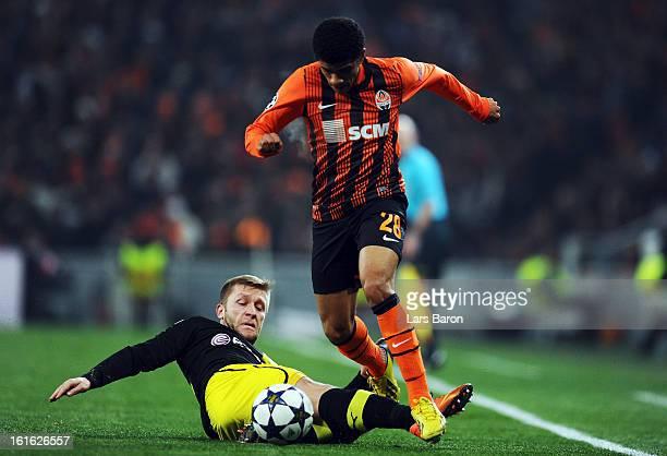 Jakub Blaszczykowski of Dortmund challenges Taison of Donetsk during the UEFA Champions League Round of 16 first leg match between Shakhtar Donetsk...