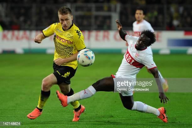 Jakub Blaszczykowski of Dortmund is challenged by Arthur Etienne Boka of Stuttgart during the Bundesliga match between Borussia Dortmund and VfB...