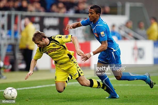 Jakub Blaszczykowski of Dortmund is challenged by Luiz Gustavo of Hoffenheim during the Bundesliga match between 1899 Hoffenheim and Borussia...