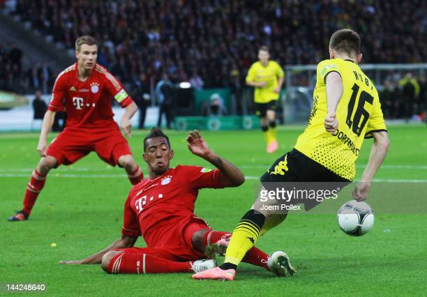 Jakub Blaszczykowski of Dortmund is fouled by Jerome Boateng of Muenchen during the DFB Cup final match between Borussia Dortmund and FC Bayern...