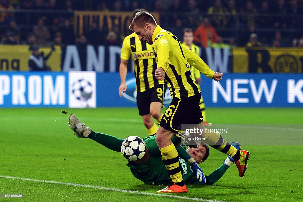 Jakub Blaszczykowski of Dortmund is on his way to score his teams third goal against goalkeeper Andriy Pyatov during the UEFA Champions League round of 16 second leg match between Borussia Dortmund and Shakhtar Donetsk at Signal Iduna Park on March 5, 2013 in Dortmund, Germany.