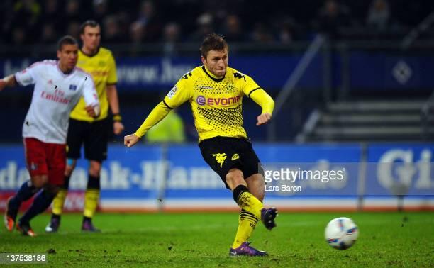 Jakub Blaszczykowski of Dortmund scores his teams fourth goal from the penalty spot during the Bundesliga match between Hamburger SV and Borussia...