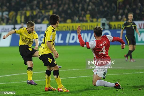 Jakub Blaszczykowski of Dortmund scores his team's opening goal during the Bundesliga match between Borussia Dortmund and FSV Mainz 05 at Signal...