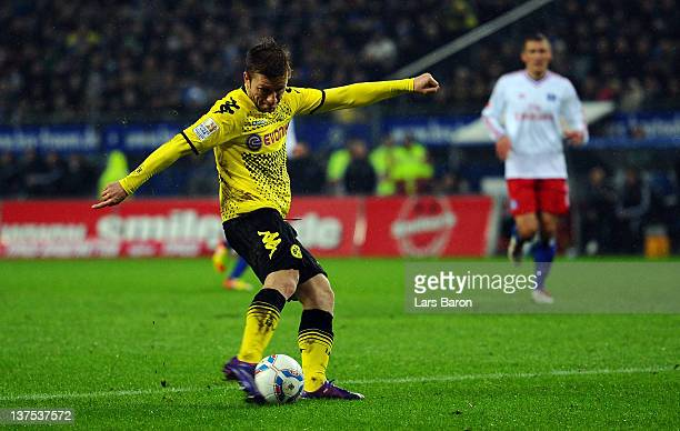 Jakub Blaszczykowski of Dortmund scores his teams third goal during the Bundesliga match between Hamburger SV and Borussia Dortmund at Imtech Arena...
